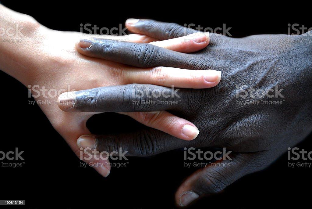 Handshake, concept of no apartheid. Hands black and white stock photo