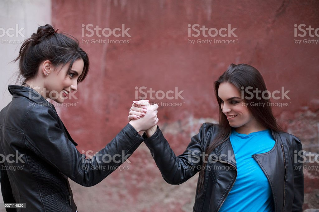 Handshake  Friends Two Beautiful Young Women Having Fun  Hip Hop stock photo