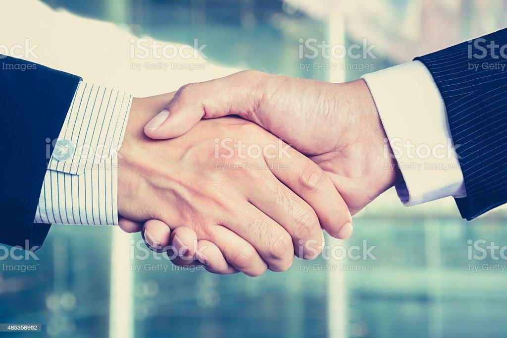 Handshake of businessmen stock photo