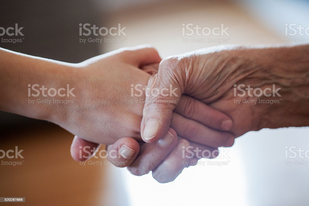 Handshake of grandmother and grandson stock photo