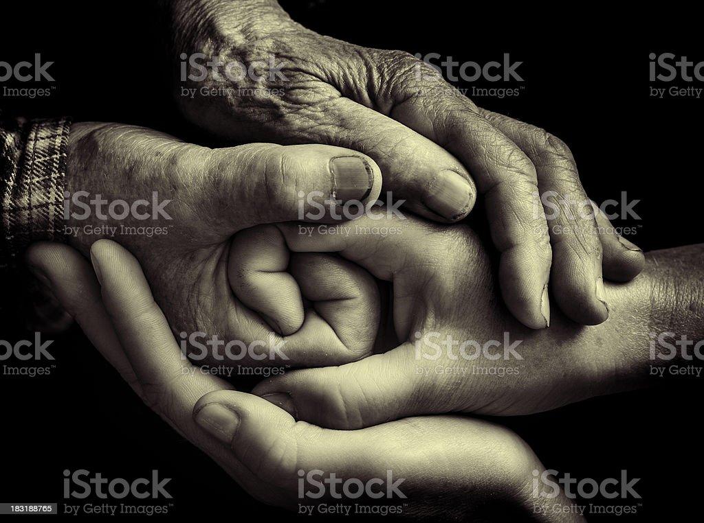 handshake of the generations stock photo