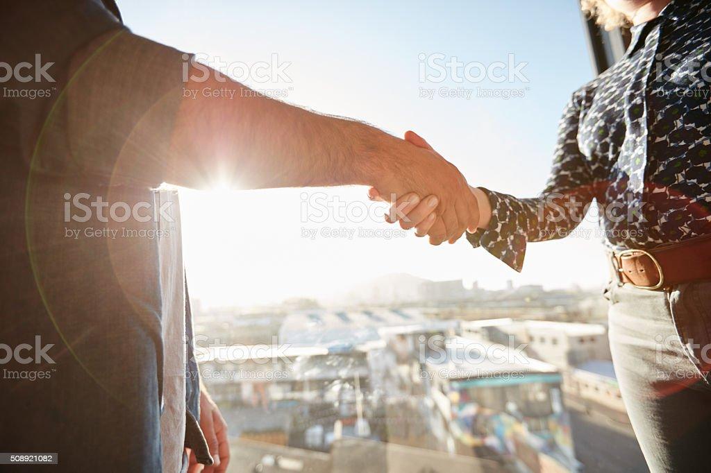 Handshake of two associates stock photo