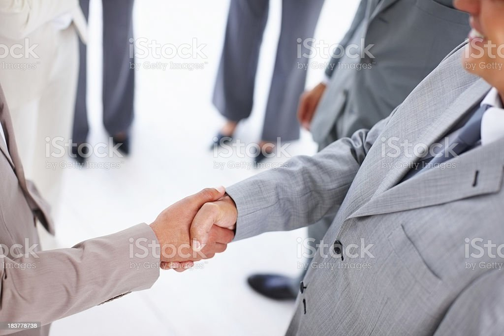 Handshake of two business men at office stock photo