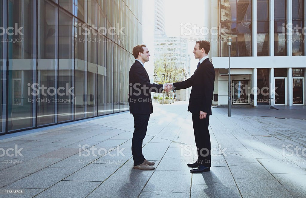 handshake of two business men stock photo