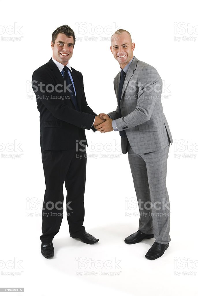 Handshake of two business partners, isolated on white - I royalty-free stock photo