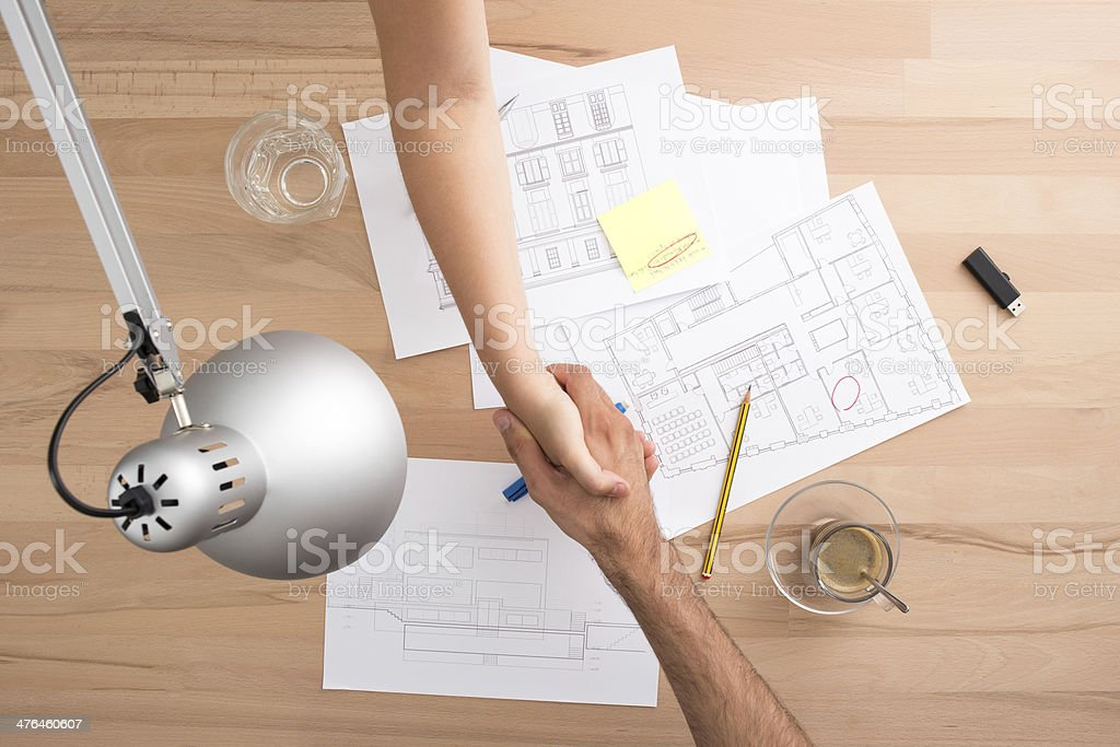Handshake on a desk royalty-free stock photo