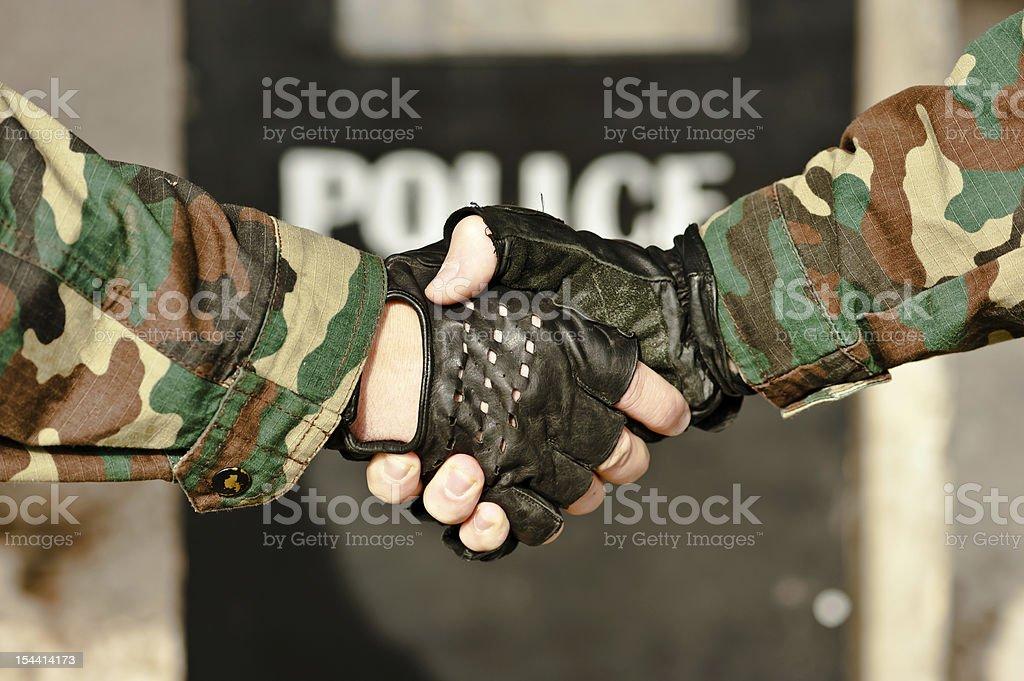 handshake police royalty-free stock photo