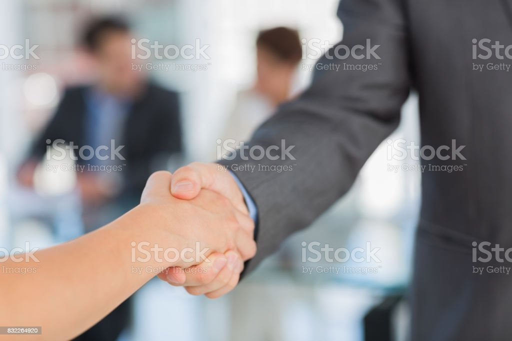 Handshake to seal a deal after a meeting stock photo