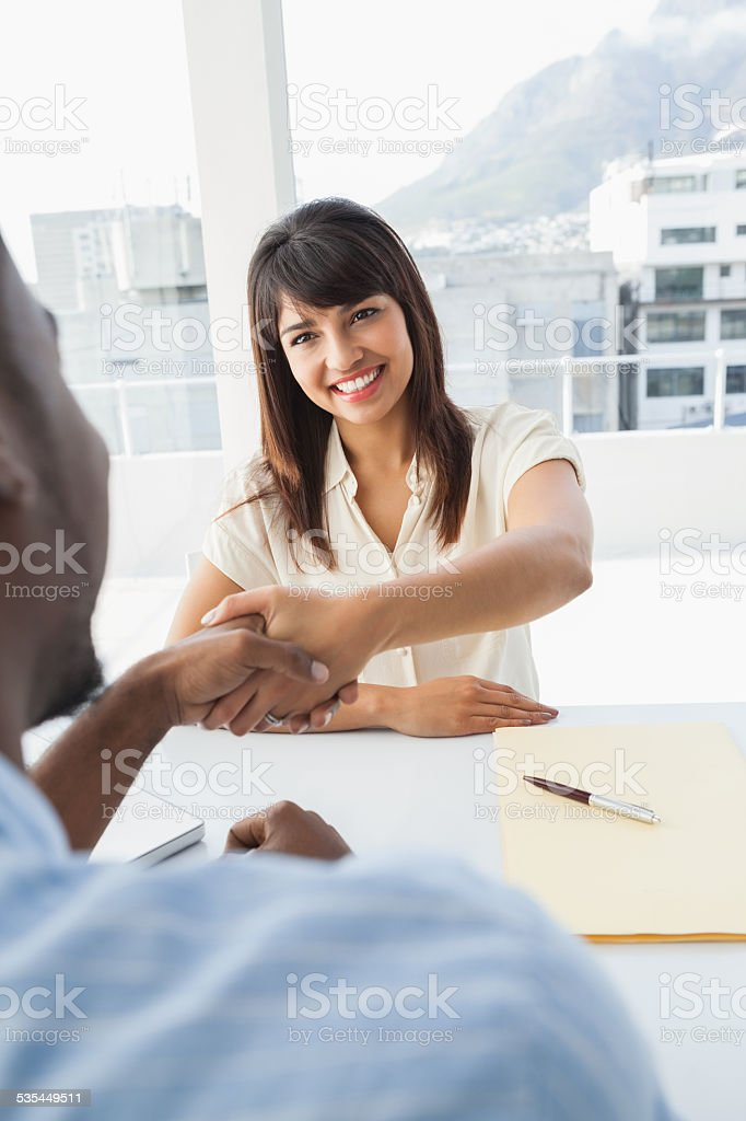 Handshake to seal deal after business meeting stock photo
