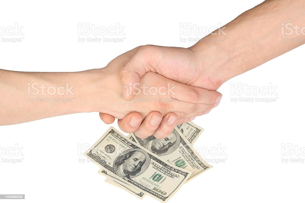 Handshake, two hands and money ($500) isolated over white background. royalty-free stock photo