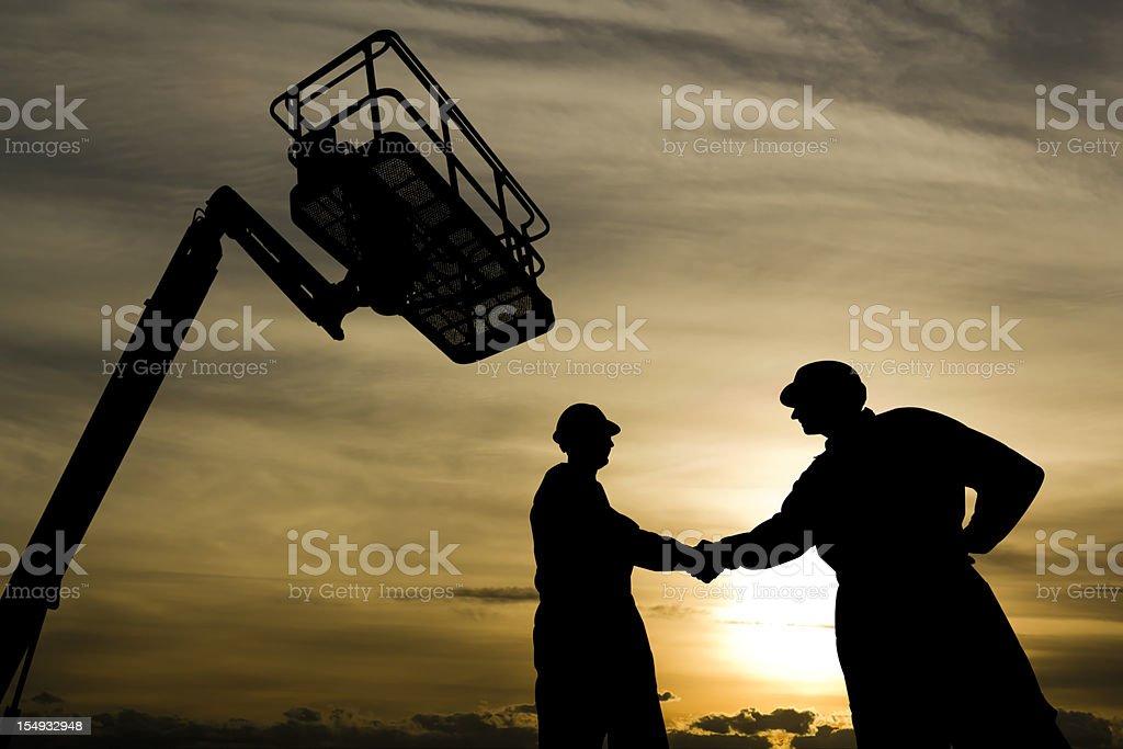 Handshake under a Lift stock photo