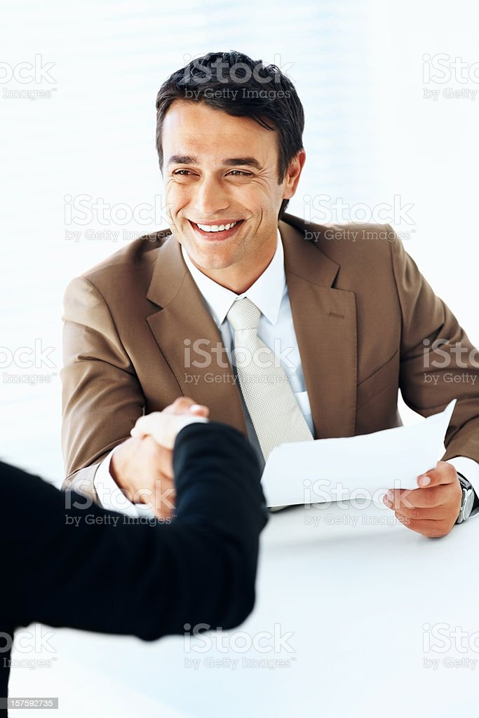 Handshake while job interviewing royalty-free stock photo