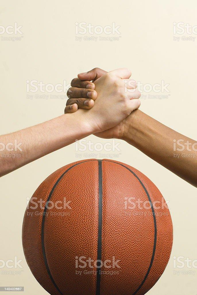 Handshake with basketball stock photo