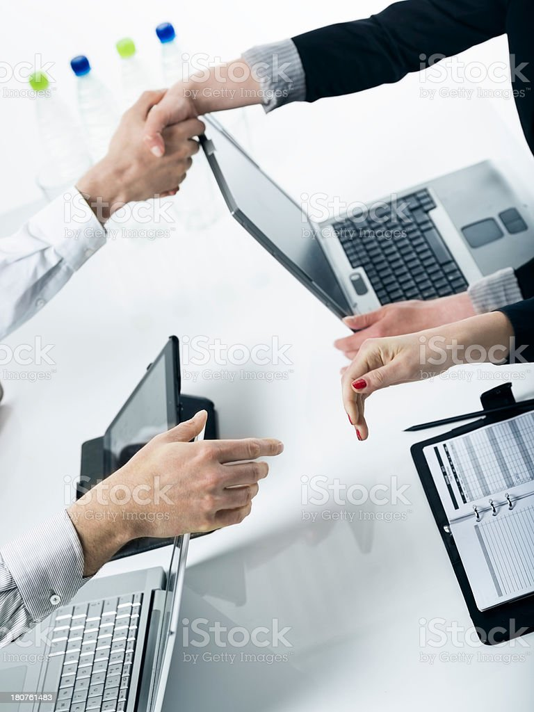 Handshakes across the table royalty-free stock photo