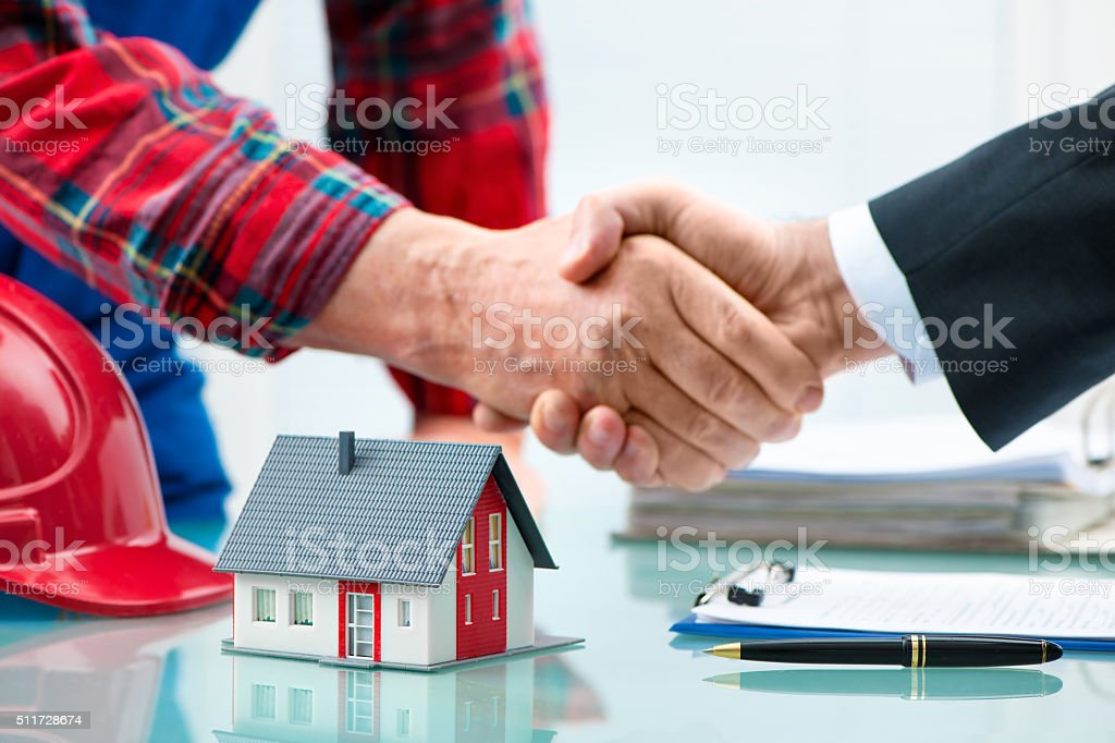 Handshakes after contract signature stock photo