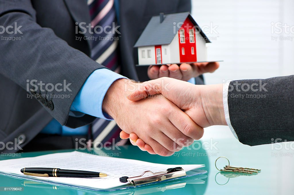 Handshakes with customer after contract signature stock photo