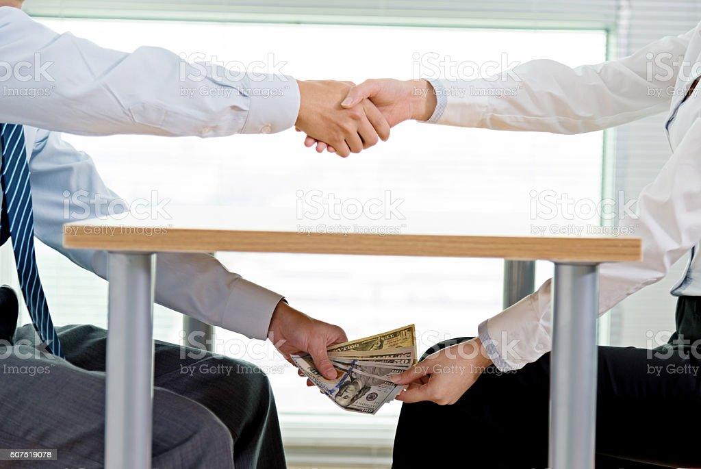 Handshaking and bribing stock photo