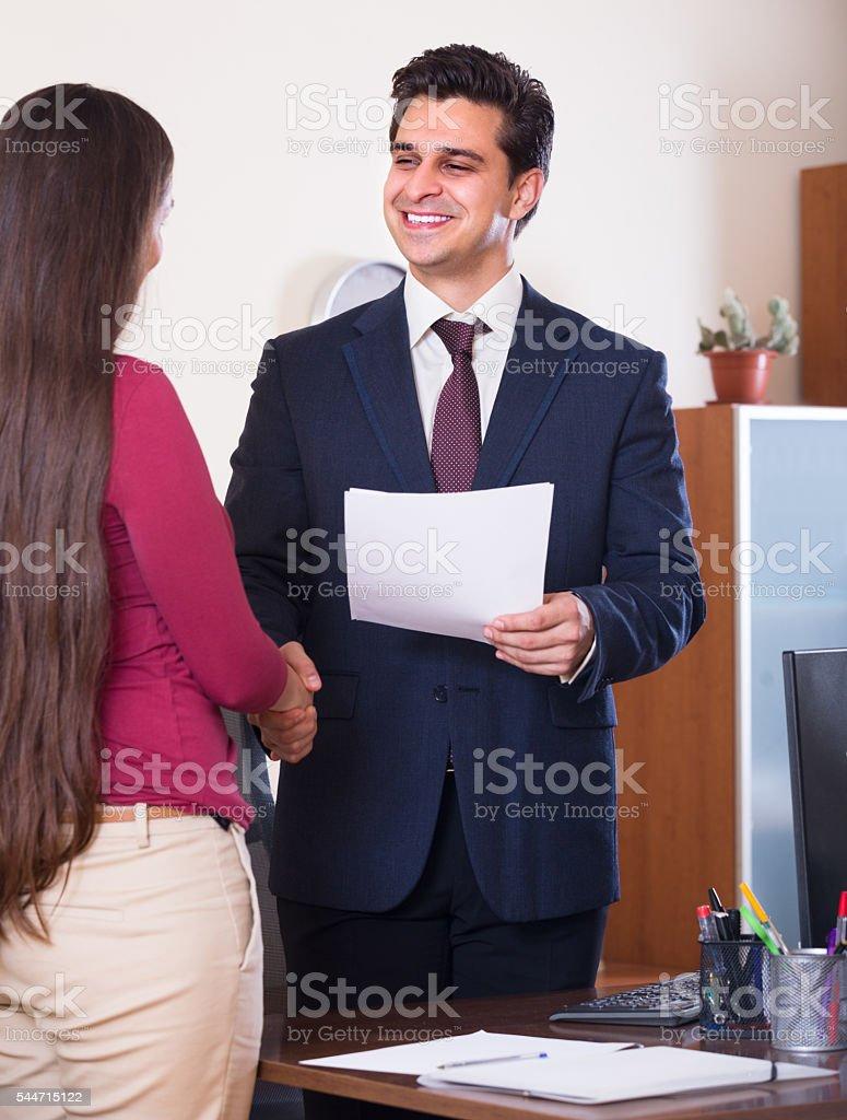 Handshaking in office stock photo