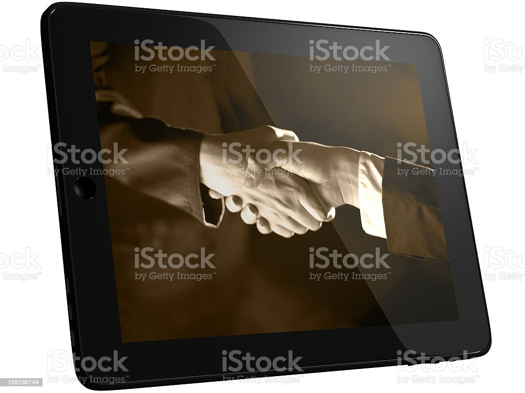 Handshaking on Tablet PC Computer royalty-free stock photo