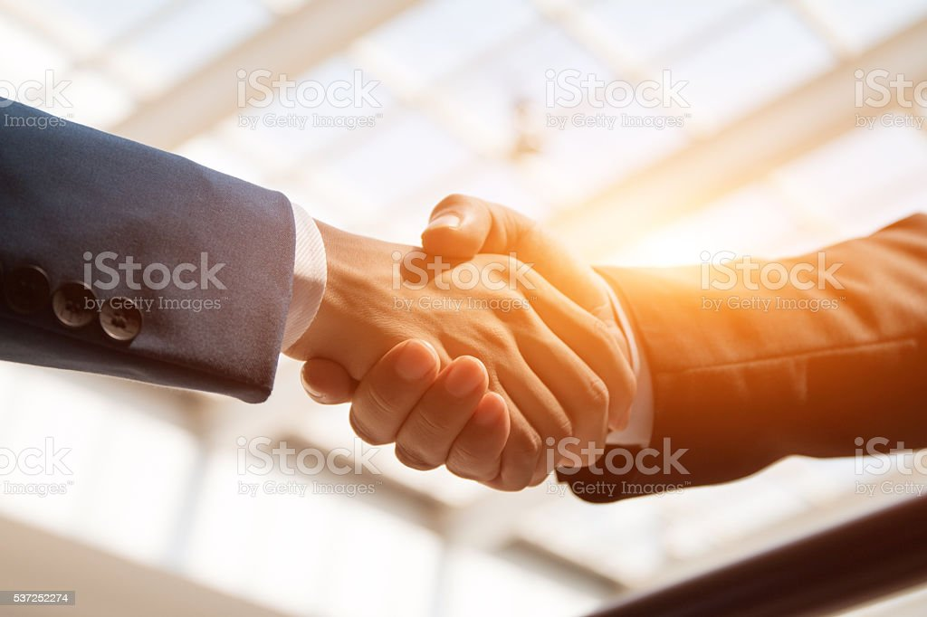 handshaking stock photo