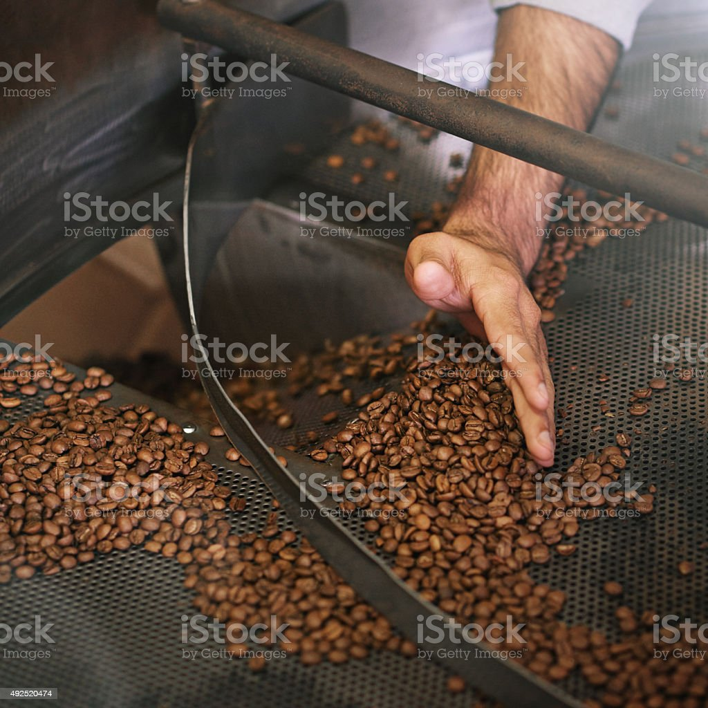 Hand-sifted beans stock photo