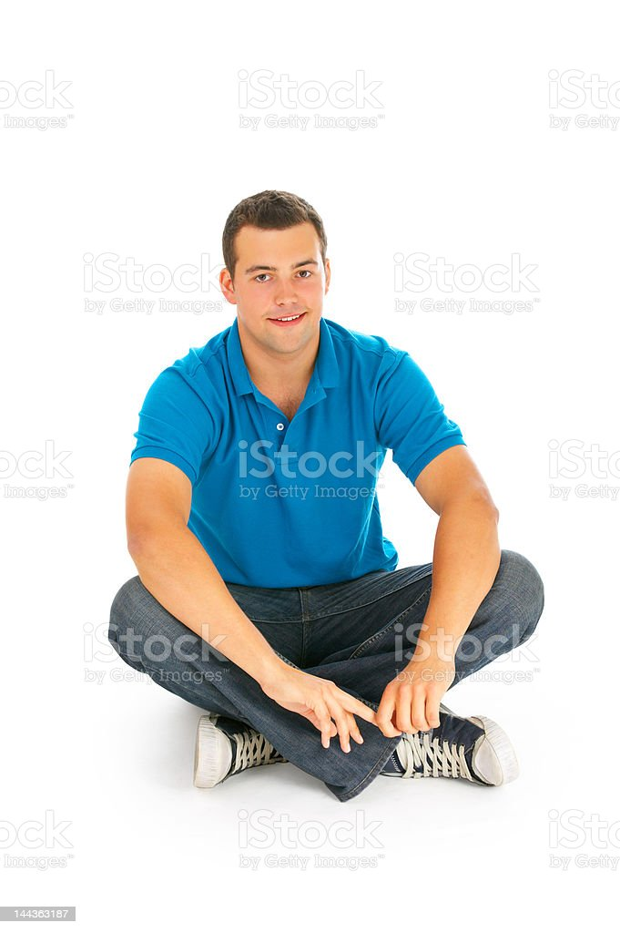 Handsom young man sitting on the floor royalty-free stock photo