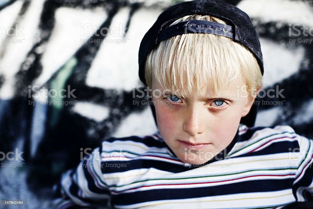 Handsome 7 year old blonde boy gazes seriously at camera royalty-free stock photo
