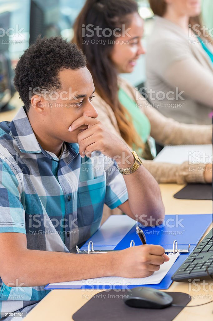 Handsome African American continuing education student stock photo