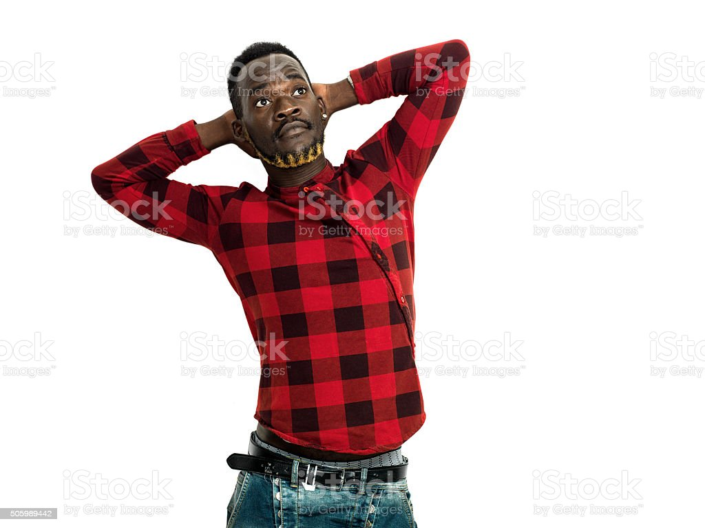 Handsome african man portrait wearing red checkered shirt stock photo