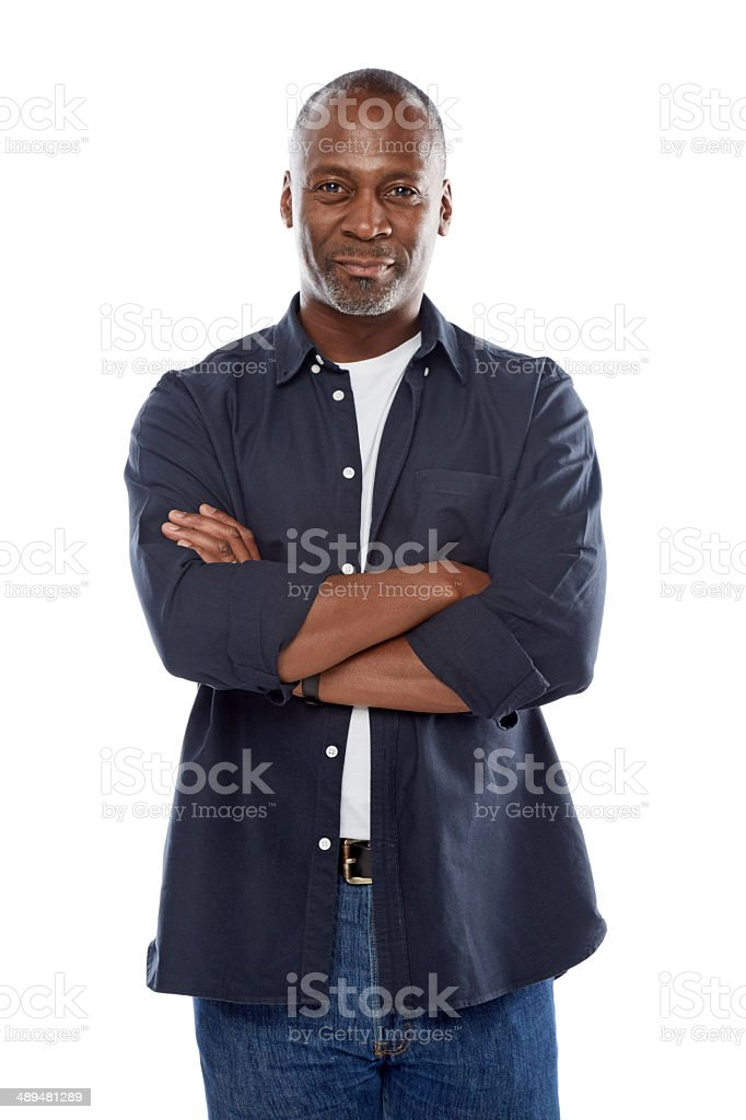 Handsome african man standing with his arms crossed stock photo