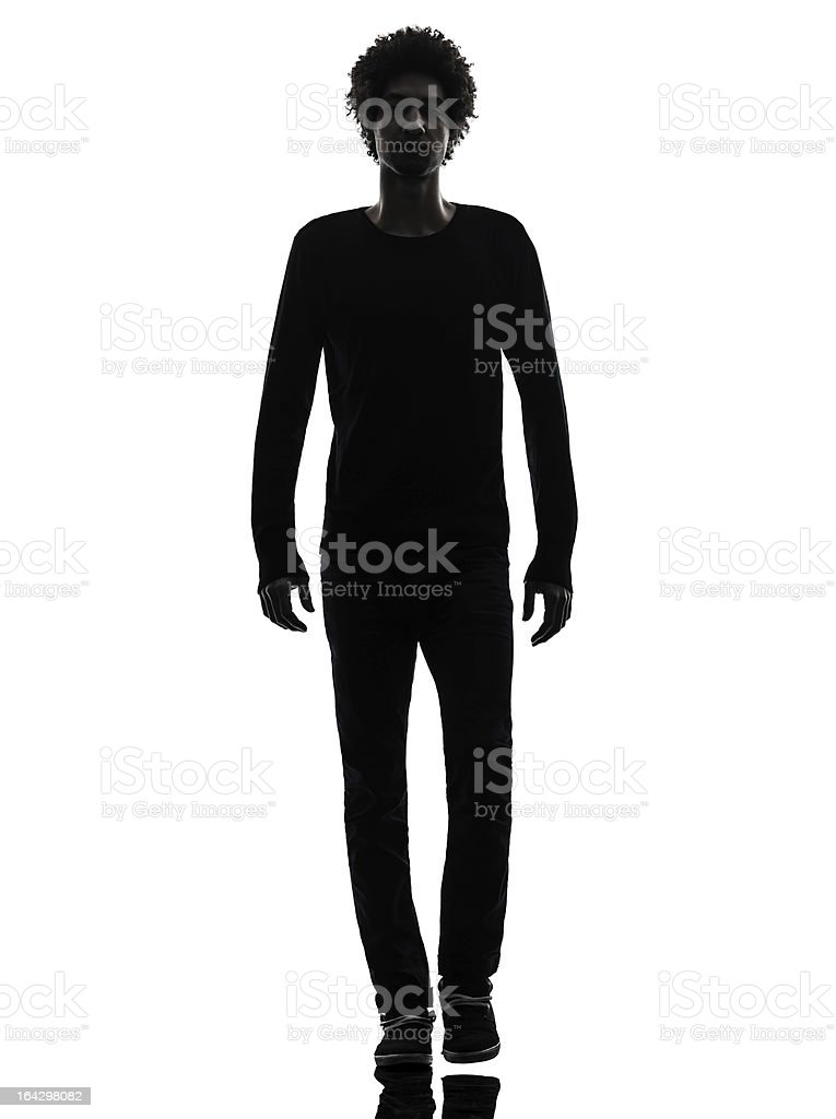 handsome african young man walking silhouette royalty-free stock photo