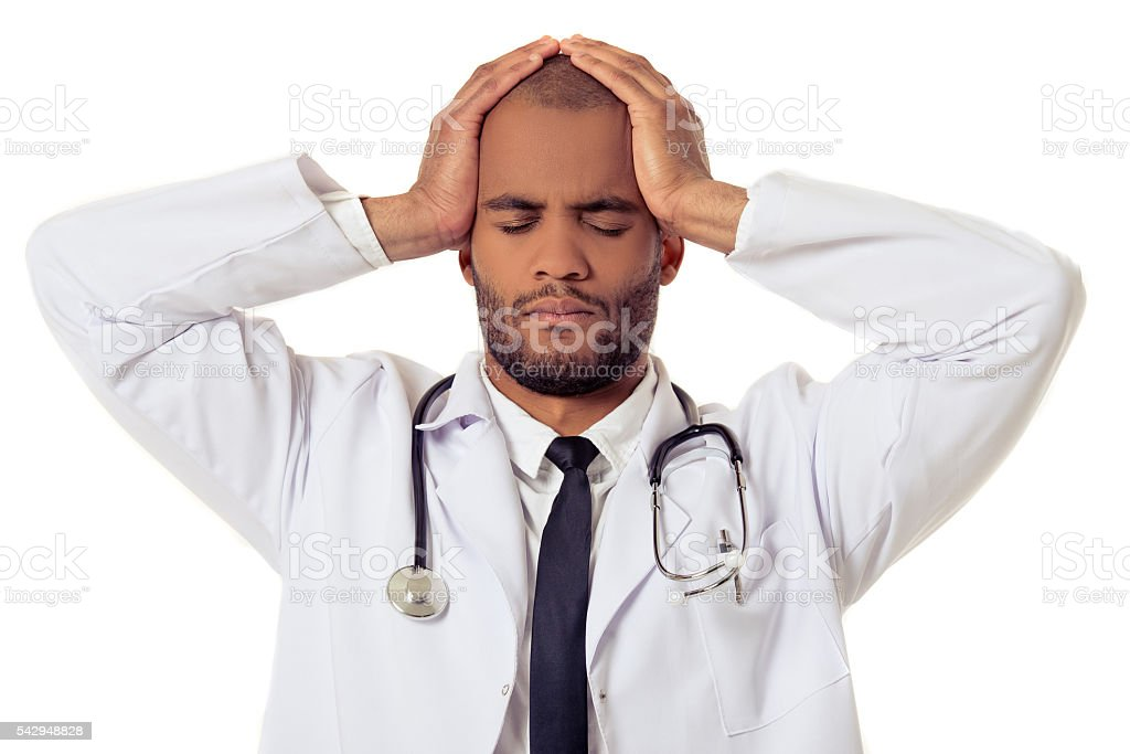 Handsome Afro American doctor stock photo