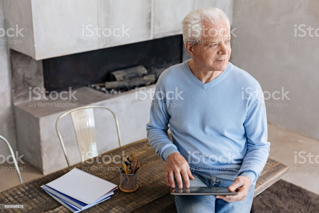 Handsome ambitious man enjoying the moment of rest stock photo