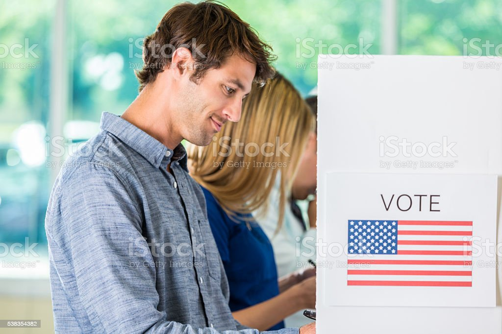 Handsome American man voting stock photo