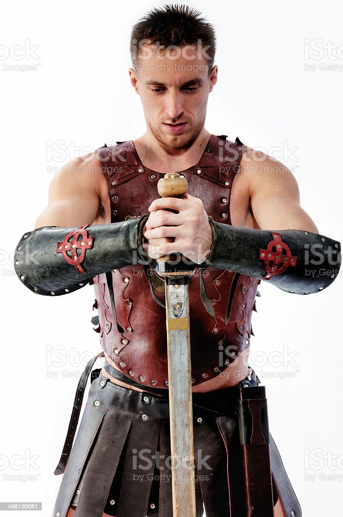 Handsome ancient armed Warrior with sword isolated on white stock photo