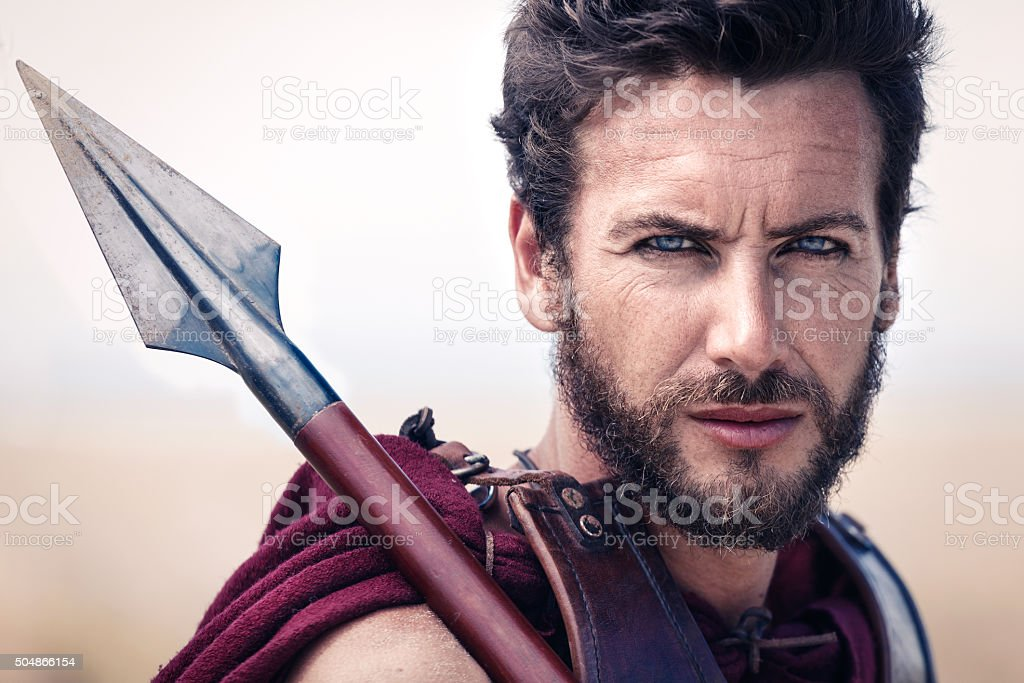 Handsome ancient warrior in armor stock photo