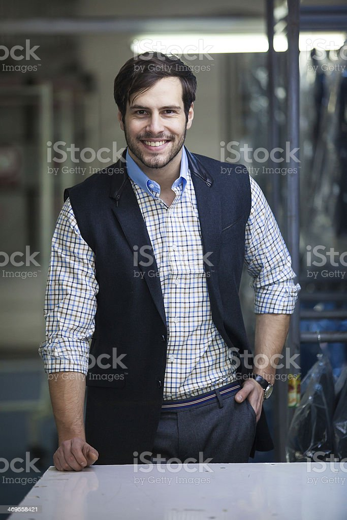 Handsome and relaxed tailor man stock photo