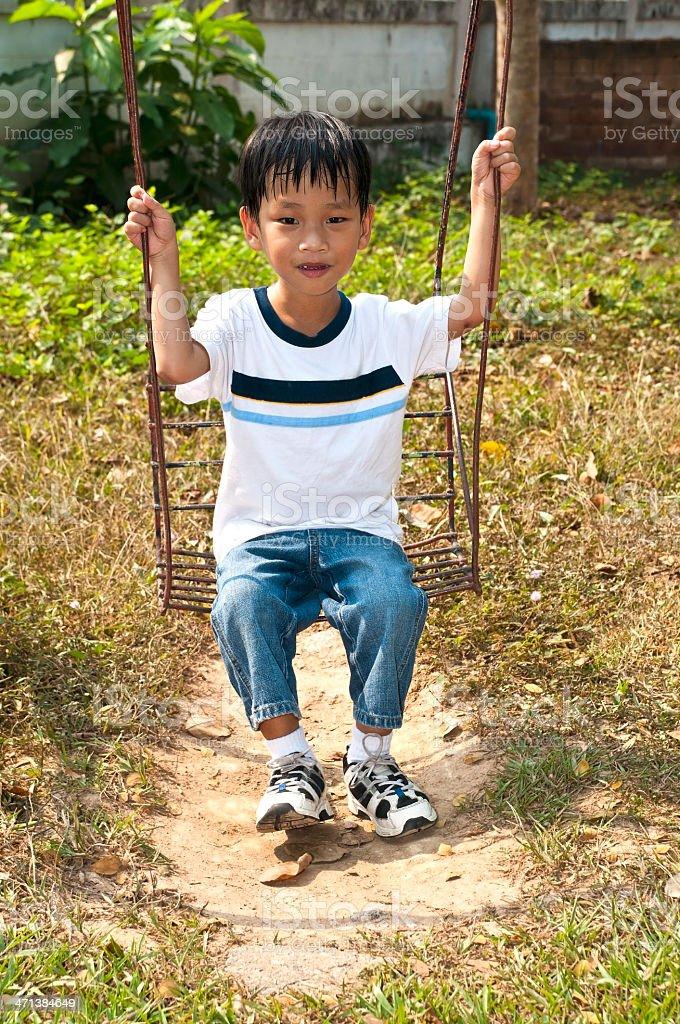 Przystojny azjatycki dziecko na plac zabaw zbiór zdjęć royalty-free