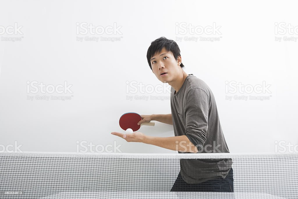 Handsome Asian man playing ping pong stock photo