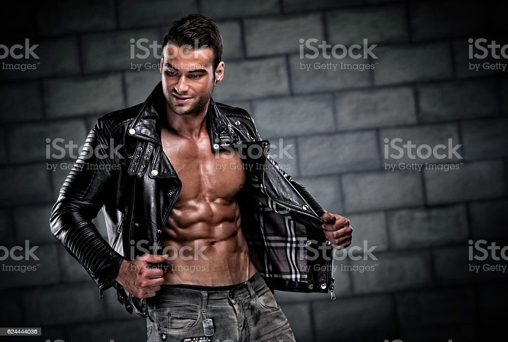 Handsome Athletic Men Wearing Leather Jacket stock photo