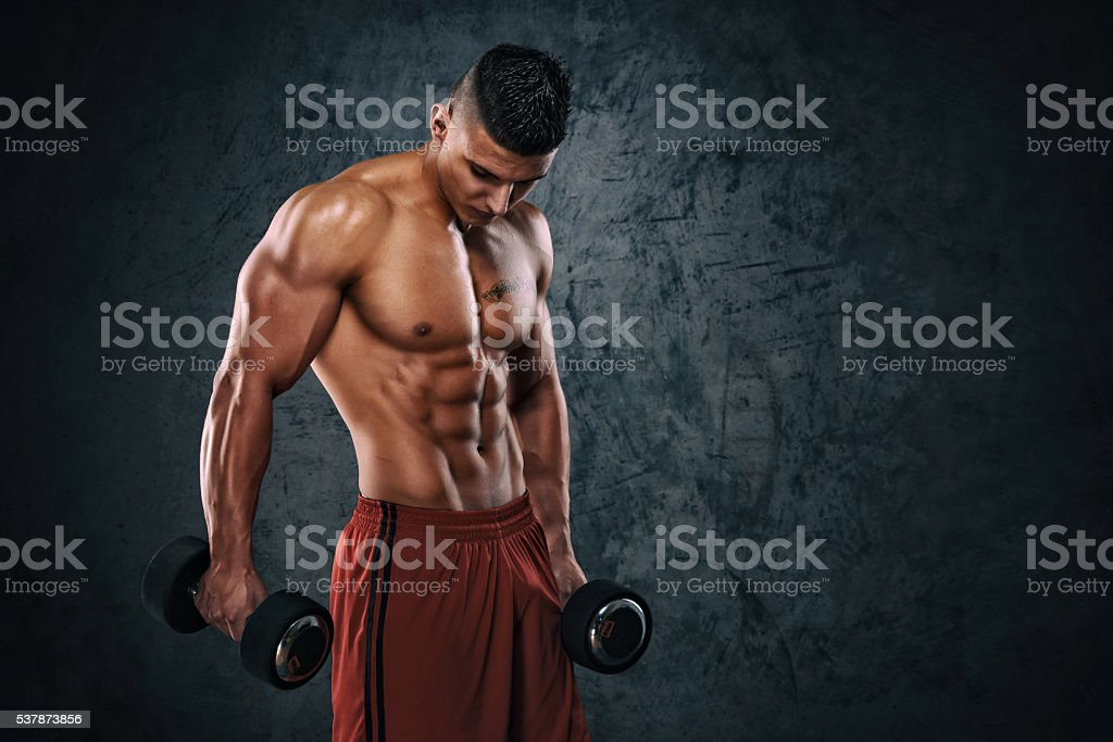 Handsome Athletic Men With Weights stock photo