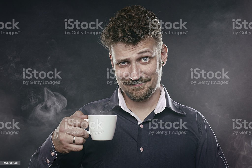 Handsome beard man stand in fog with cup of coffee stock photo
