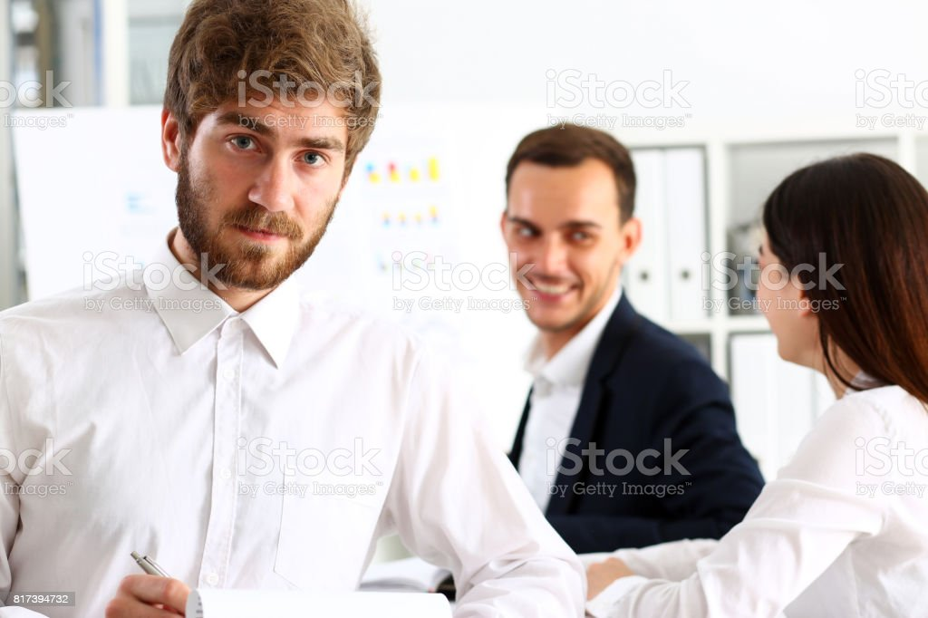 Handsome bearded man in office stock photo