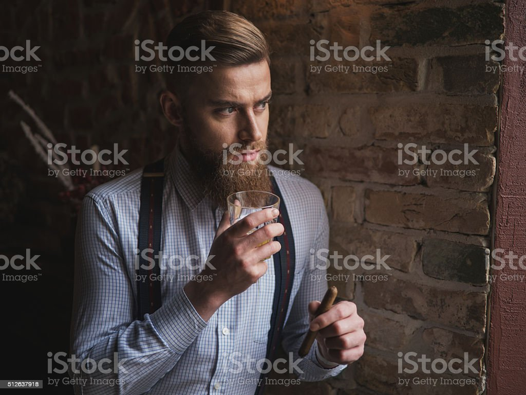 Handsome bearded man is showing his richness stock photo
