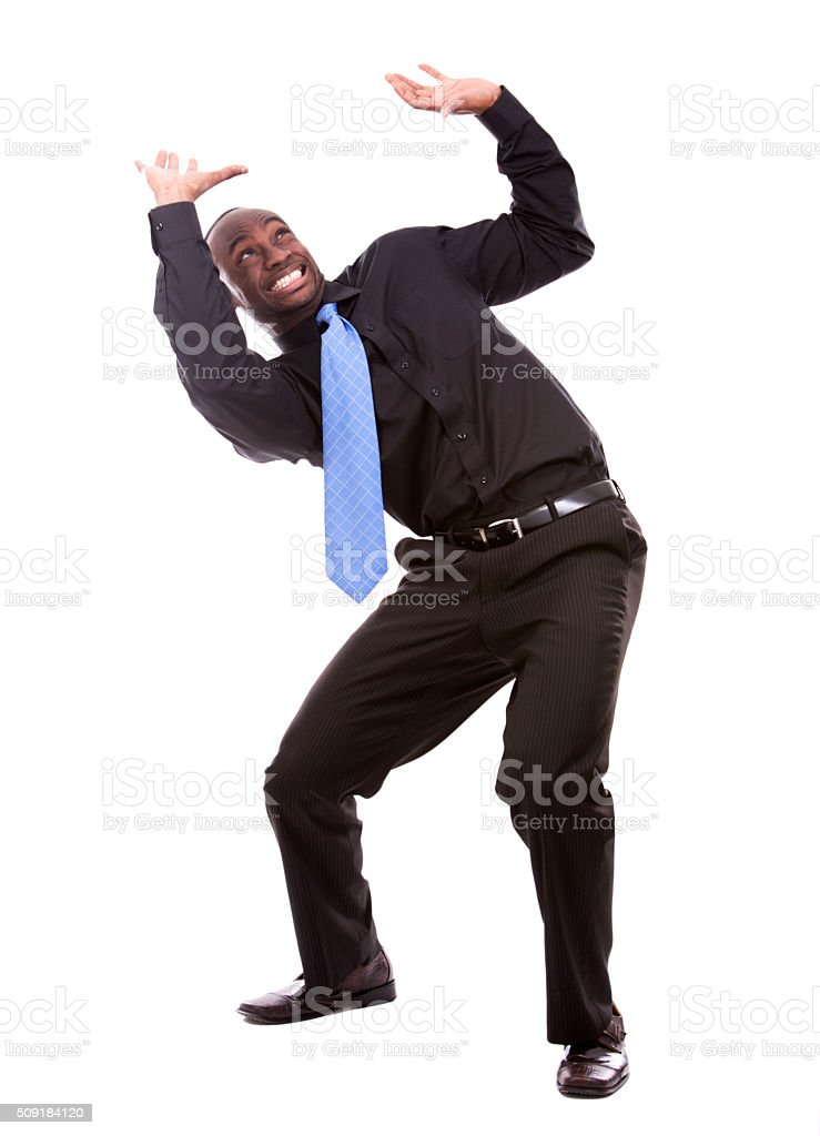 handsome black man pushing object stock photo