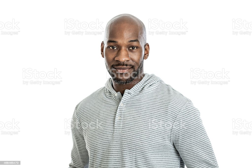 A handsome black man with a bald head on a white background stock photo