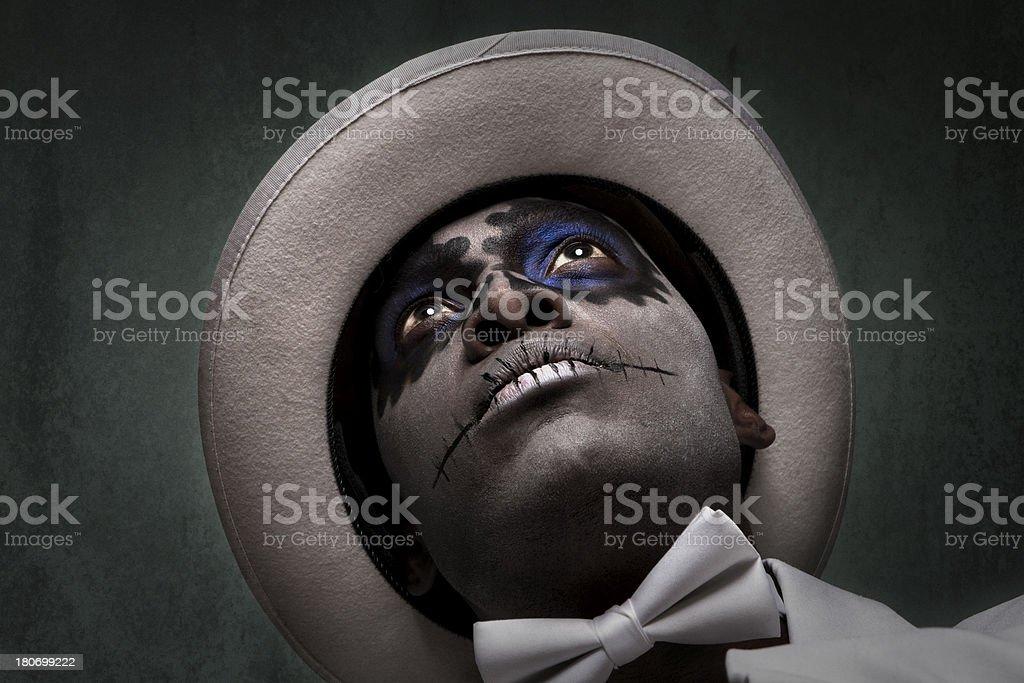 Handsome Black Man with Sugar Skull Makeup stock photo