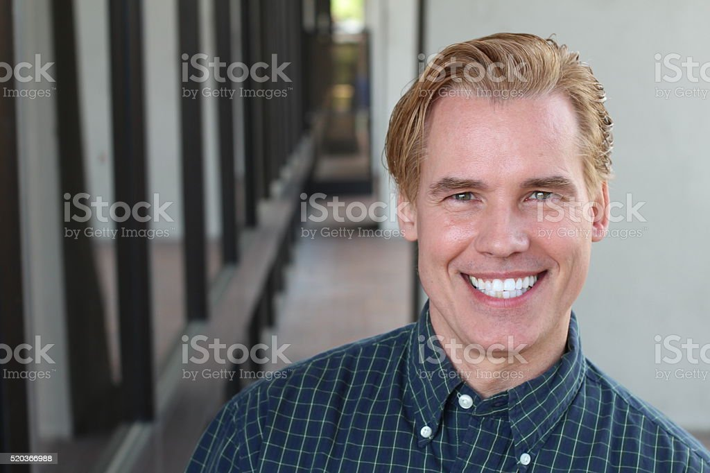 Handsome blonde man with a perfect smile stock photo