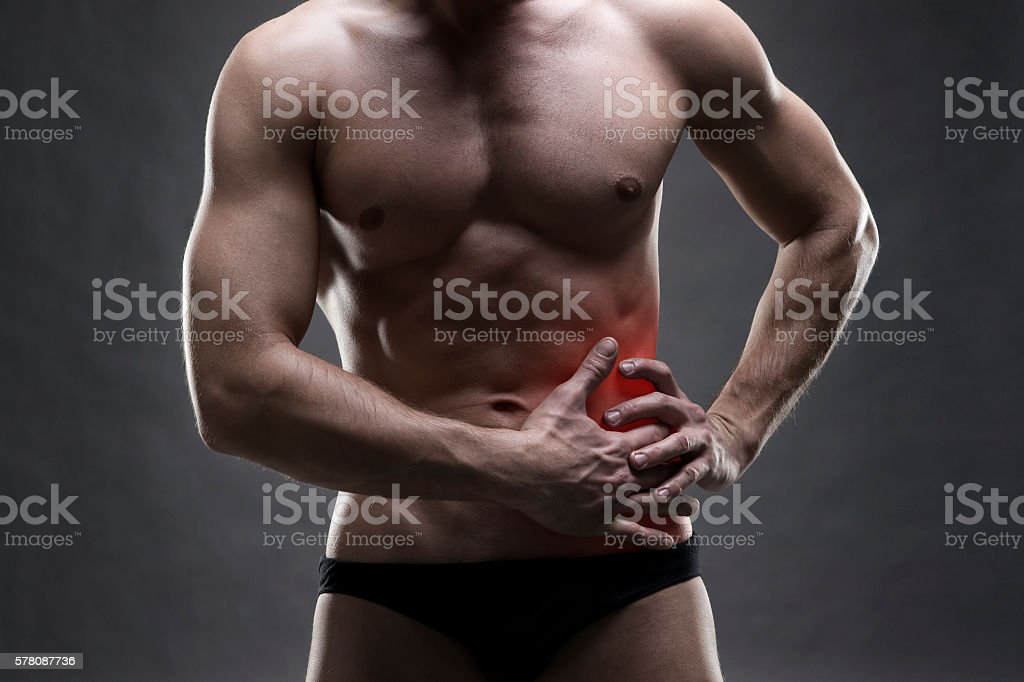 Handsome bodybuilder posing on gray background stock photo
