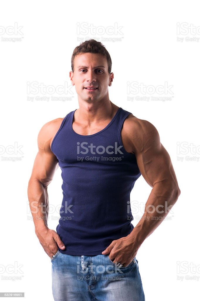 Handsome bodybuilder smiling at camera isolated on white stock photo